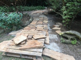 Flagstone path to garage door.